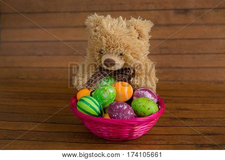 Easter Colorful Eggs In Basket And Plush Bear