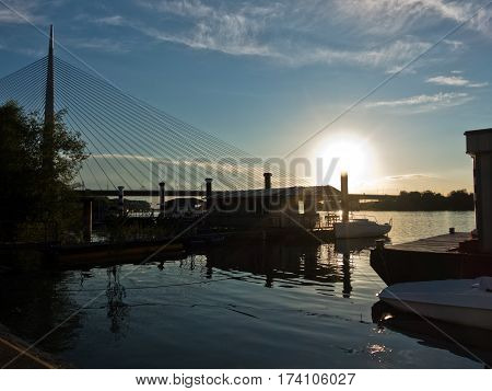 Sava river at sunset with cable bridge in background, Belgrade, Serbia