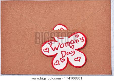 Card on cardboard. Laconic greeting for Women's day.