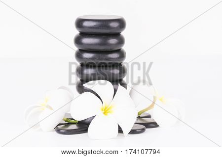 Spa concept with zen stones and Frangipani flowers on white background