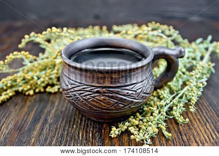Tea With Wormwood In Cup On Board