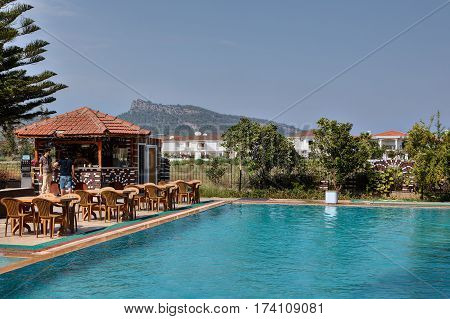 Camyuva Kemer Antalya Turkey - 29 august 2014: Swimming pool in the open air with a bar for hotel guests and a barbecue area.