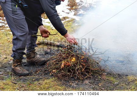 kindle fire in the forest the smoke spread along the ground travel in the winter