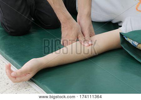 Deep tissue massage on arm closeup .