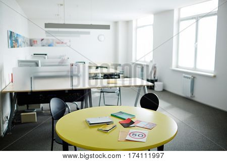 Image of modern work space in grey and white with meeting table in front