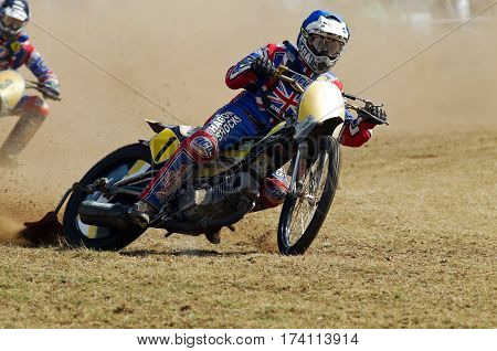 SWINGFIELD, UK - AUGUST 18: A member of the UK grasstrack team leads the field into the top corner of the circuit during the Longtrack World Championships on August 18, 2013 in Swingfield