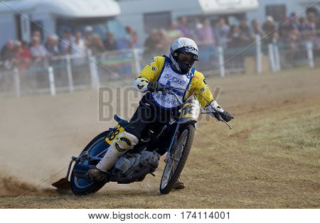 SWINGFIELD, UK - AUGUST 18: A lone rider from the Finnish Longtrack grasstrack team heads around the bottom corner at speed during the Longtrack World Championships on August 18, 2013 in Swingfield
