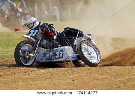 SWINGFIELD, UK - AUGUST 18: An unnamed grasstrack sidecar team compete in the UK championships alongside the solo World Championships on August 18, 2013 in Swingfield