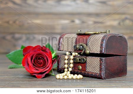 Mother's Day gift: Pearls in wooden  jewelry box and red rose