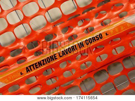 Plastic Orange Safety Net With Words Attenzione Lavori In Corso