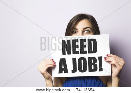 Unemployment girl looking for a job text