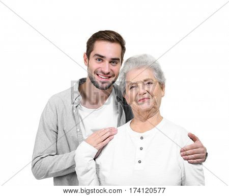 Grandmother with adult grandson on white background