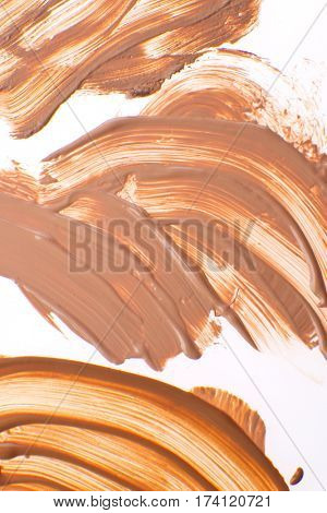 smudged liquid foundation isolated on white