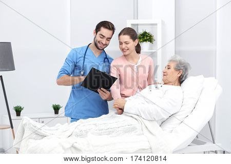 Grandmother, granddaughter and doctor at hospital