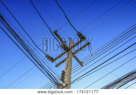 electricity post high voltage and cable line on Sky Blue background.