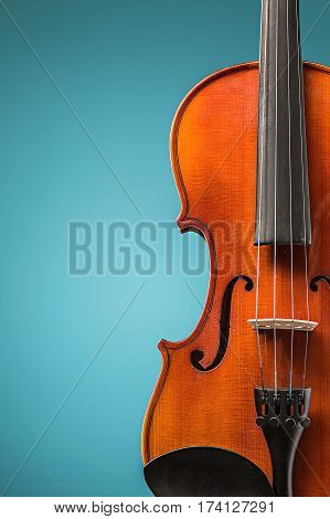 Violin front view on blue studio background