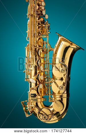 Saxophone - Golden alto saxophone classical instrument on blue