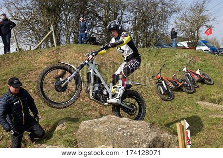 ASTON TIROLD, UK - MARCH 13: Becky Cook negotiates a large rock boulder during a mid section run at the UK Ladies National Trails championship at Seymours Arena on March 13, 2016 in Aston Tirrold
