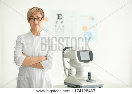 Mature female ophthalmologist in clinic