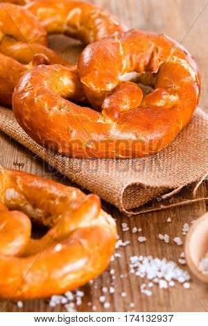 Group of bavarian pretzels on wooden table.