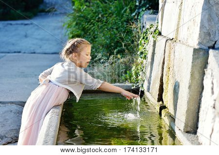 Girl Near The Fountain