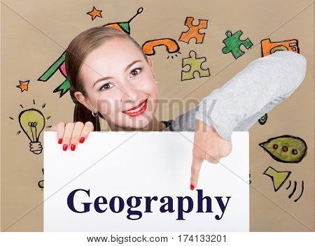Young woman holding whiteboard with writing word: geography. Technology, internet, business and marketing