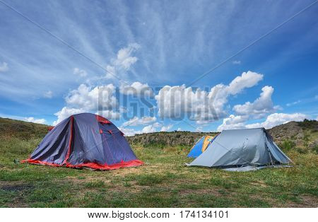 Summer landscape with tents on meadow ,