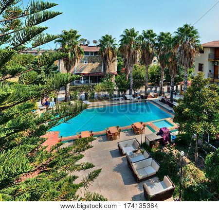 Camyuva Kemer Antalya Turkey - 29 august 2014: Outdoor swimming pool on the territory of a small hotel for guests at the resort.