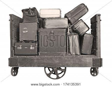 Cart full with old Suitcases on a white background