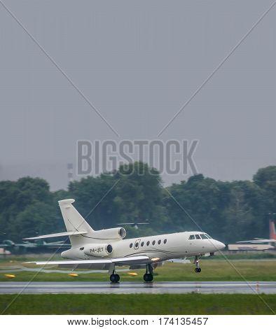 Kiev Ukraine - June 5 2012: Dassault Falcon 50EX business jet is landing in bad weather conditions under heavy rain