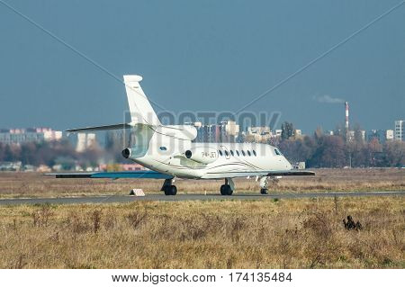 Kiev Ukraine - November 5 2011: Dassault Falcon 50EX business jet is taking off from the runway on a sunny autumn day