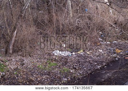 Little smelly landfill in an abandoned park