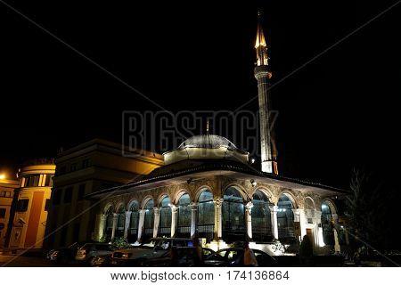 TIRANA, ALBANIA - SEPTEMBER 27: The Et'hem Bey Mosque at night on Skanderbeg Square, Tirana, Albania on September 27, 2016.
