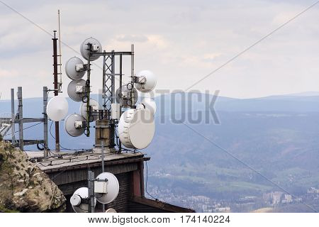 Telecommunication Transmitters And Aerials With City In Background