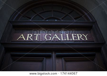 Art gallery sign above entrance to local gallery