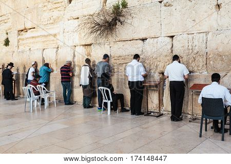 The Western wall or Wailing wall in the old city of Jerusalem, Israel. Jews pray at the wall of the temple.