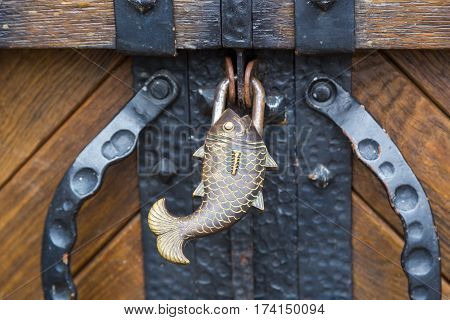 fish-shaped padlock. Pad in the shape of a fish