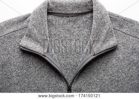 Grey Fleece Sweater Fabric Texture With Zipper On White Background Close Up.