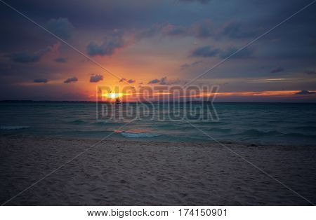 Beach sunset on Playa Norte in Isla Mujeres, Mexico.