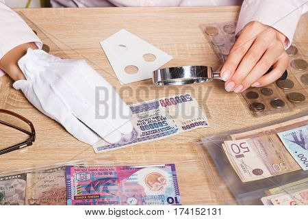Turkish Lira And Magnifying Glass In The Woman's Hand