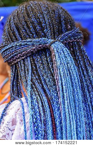 Long blue braids worn by a member of a carnavaval association in Rio de Janeiro for presentation