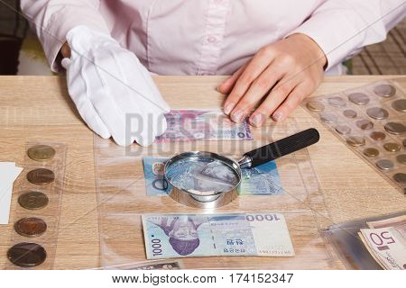 Hands With A Set Of Bills In The Pockets