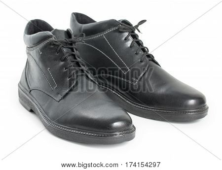 Pair Of Black Mens Leather Winter Boots Isolated On A White Background