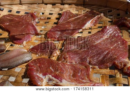 Dried meat and fish in the threshing basket.