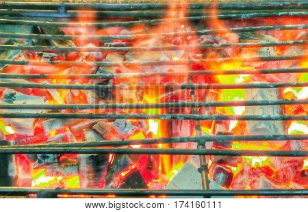 Unique colors of the flames from the sweltering heat of the grill.