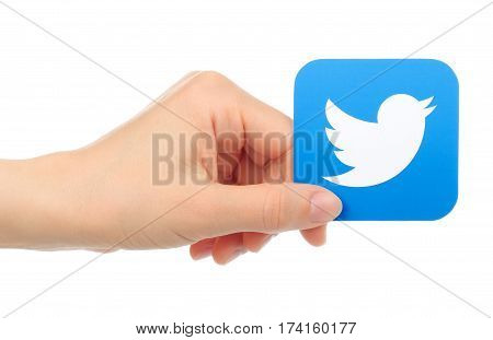 Kiev Ukraine - May 17 2016: Hand holds Twitter icon printed on paper. Twitter is a well-known social networking and news service