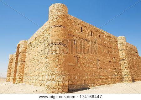 Exterior of the desert castle Qasr Kharana (Kharanah or Harrana) near Amman, Jordan. Built in 8th century used as caravanserai.