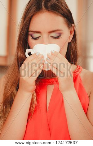 Pretty Woman Drinking Tea Or Coffee At Home.