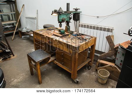 Workplace with a drill and vice. Work at a factory. Drilling Machine