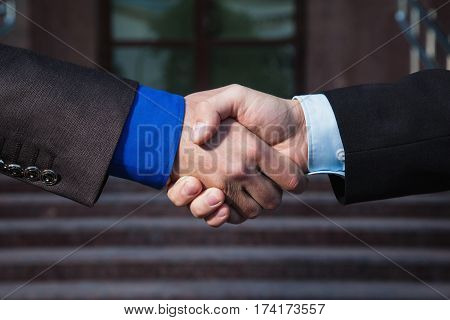 Friendship concept. Business agreement. Handshake on background Bank. Shake hands with each other. Friendship partners. Business friendship